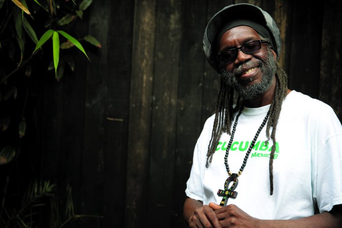 "Macka B's words, sound and power was forged in the red hot heat of UK sound-system culture. Inspired by H.I.M. Ras Tafari and pioneer DJ's such as U-Roy, I-Roy, Big Youth, his lyrical flow for Wassifa Hi-Fi at a now legendary London/Brum clash with Saxon caught the ears of Fashion Records who brought him down to London faster than HS2* to record his solo debut 'Bible Reader'. A link up with up Mad Professor followed leading to a string of hit albums and singles for Ariwa and an extensive tour schedule increasing Macka's international profile while delivering a crossover chart in Hawaii with 'Bob'. Over the years Macka has collaborated with a veritable who's who of dynamic talent including Horace Andy, Baaba Maal, Freddie McGregor, Steel Pulse, Luciano and Gregory Isaacs while sharing the stage with a whole heap of legendary reggae icons. In 2015 Macka B released the Peckings Brothers produced album 'Never Played A 45' which, as well as the in-demand title track, featured 'Medical Marijuana Card' the animated video of which amassed over 600,000 YouTube views. Now teaming up with Greensleeves records Macka B delivers 'Health Is Wealth' a highly anticipated album including the viral hit, 'Cucumba'. The video has amassed over 43 million views so far on UNILAD's Facebook page https://www.facebook.com/UNILADSound/videos/428506530826328/?autoplay_reason= all_page_organic_allowed&video_container_type=0&video_creator_product_type=2&ap p_id=2392950137&live_video_guests=0 'Cucumba' has received Breakfast show support in the UK by Nick Grimshaw on BBC Radio One, in NYC by Ebro on Hot 97FM and LA by BigBoy on iHeart Real 92.3. This has resulted in guest spots on BBC Radio 4, BBC Radio 5, BBC World Service & BBC Radio London, plus UK national press in the Daily Mail Newspaper. http://www.dailymail.co.uk/femail/article-4321476/Reggae-artist-goes-viral-freestyleCUCUMBERS.html Reflecting Macka B's world-wide fanbase 'Health Is Wealth' features tracks produced in Jamaica, Germany & Japan 'longside recordings made in Macka's Black Country heartland as well as the London studios of Mafia & Fluxy & Stingray. Included are ""Wha Me Eat (remix)' a vegan anthem given new life and fully supported by Macka B TV, newly launched 'Wha Me Eat' health supplements and clothing line, the fresh ganja anthem ""Natural Herb' over a South Rawkus cut of Sleng Teng, tributes to the reggae greats in the two cuts of 'Legendary Reggae Icons' over fresh do-overs of 'My Conversation' and 'Here I Come' plus a heartical re-lick of Ras Michael's 'None A Jah Jah Children' in combination with Billboard hit-maker Maxi Priest. Macka B is a true global messenger for reggae music utilising social media for his 'Medical Mondays' & 'Wha Me Eat Wednesdays' as well as taking his live show across five continents to perform sell out shows in Jamaica, Hawaii, Japan, China, Philippines, Vietnam, Thailand, Germany, France, Belgium, Italy, Spain, Poland, Slovenia, Croatia, Serbia, South Africa, Senegal, Sierra Leone, New Zealand, Australia. *HS2 is the proposed ""High Speed Train"" linking London with the midlands & north of England"